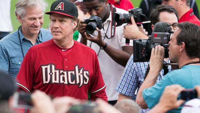 Actor Will Ferrell plays left field for the Arizona Diamonbacks during their spring training game against the Cincinnati Reds at Salt River Fields at Talking Stick on Thursday, March 12, 2015.