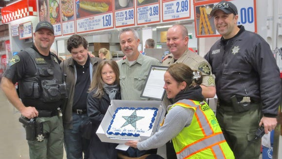 John Borgman, center, is honored by Marion County Sheriff's