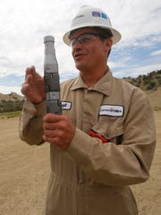 ConocoPhillips project supervisor Virgil Chavez talks about the tools they use on June 30,during a tour of ConocoPhillips natural gas site in Aztec.
