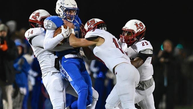 Malone University redshirt freshman Ariq Johnson, shown body-slamming a Anthony Wayne player two years ago for La Salle High School, will need to make some decisions now that the university decided to eliminate the football program.