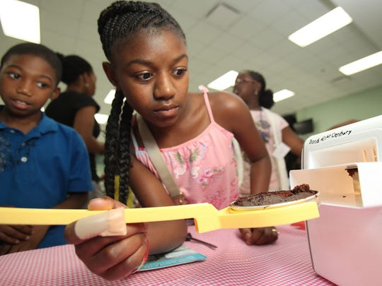 Bond Elementary students participate in project-based learning activities in an after-school program funded by a federal grant.