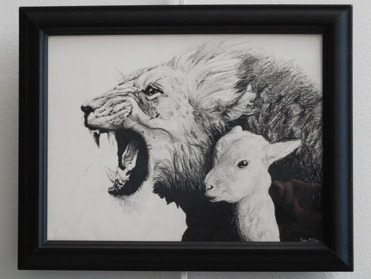 636619808201900660-The-Lion-and-the-Lamb-by-Jaden-Story-of-Montford-Middle-School-is-on-display-at-the-City-Hall-Gallery.JPG