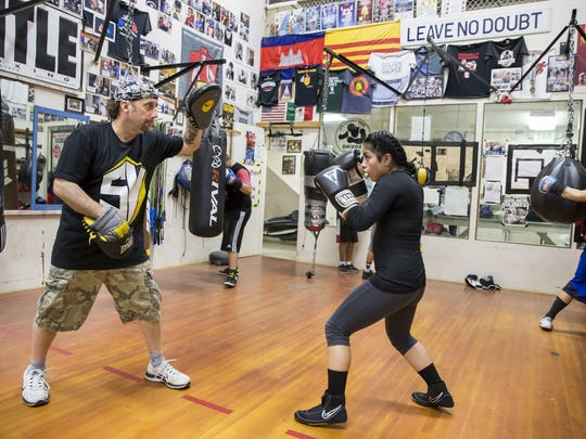 Vanessa Rojas trains with coach Keith Weir at the White Center PAL Boxing Gym Feb. 28, 2017 in SEattle. Rojas is one of several female boxers at the gym, which has about 30 regulars boxing weekdays after school.