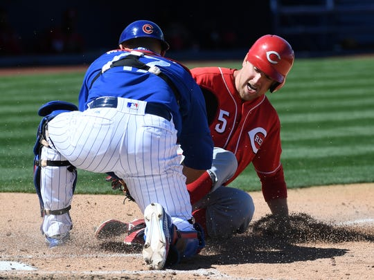 West Nyack's Patrick Kivlehan of the Cincinnati Reds is tagged out at home plate on a fielder's choice by catcher Miguel Montero of the Chicago Cubs during the fifth inning of their exhibition game at Cashman Field on March 25, 2017 in Las Vegas, Nevada. The Cubs won 11-7.