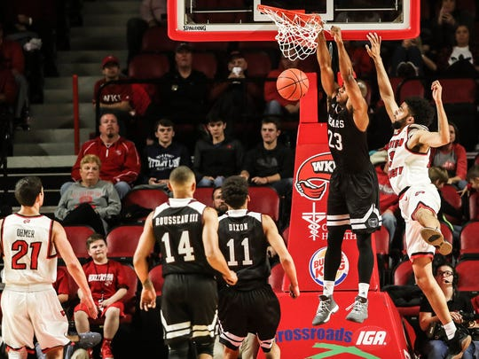 Missouri State Bears guard James Miller (23) dunks