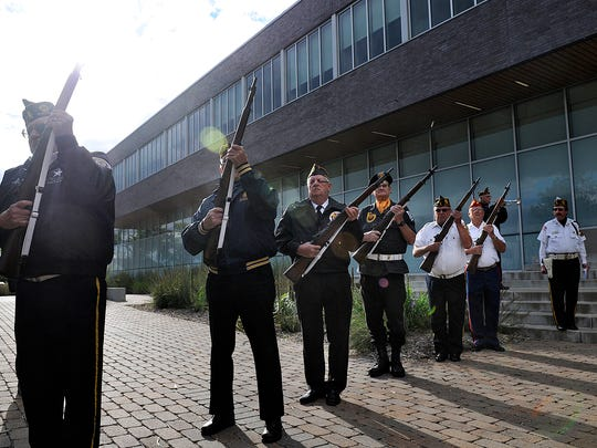 Metro Vets members fire a rifle salute during Thursday's Sept. 11 Community Commemoration Ceremony at the St. Cloud police station.