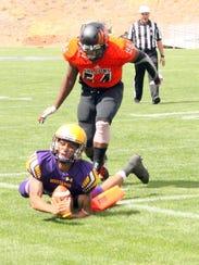Western quarterback Javia Hall dives toward the pylon