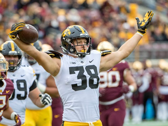 Oct 6, 2018; Minneapolis, MN, USA; Iowa Hawkeyes tight end T.J. Hockenson (38) celebrates after scoring a touchdown against the Minnesota Golden Gophers in the first quarter at TCF Bank Stadium. Mandatory Credit: Jesse Johnson-USA TODAY Sports