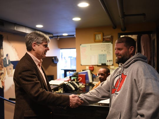 Dave Scott is the executive director of Market Street Mission in Morristown, NJ. The mission ministers to the needy people in the community. Dave Scott shakes hands with Joseph Gallow the Assistant Resident Director, who went theough the program. Shown on Thursday December 14, 2017. #weareonenation