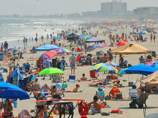 Spring breakers and beach goers pack Cocoa Beach.