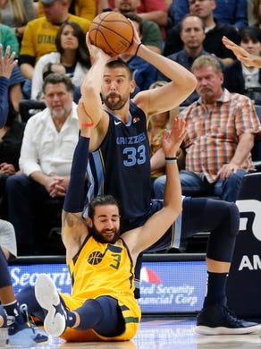 Memphis Grizzlies center Marc Gasol (33) passes the ball as Utah Jazz guard Ricky Rubio (3) defends in the first half during an NBA basketball game, Monday, Oct. 22, 2018, in Salt Lake City. (AP Photo/Rick Bowmer)
