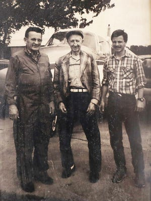 Chuck Norman, left, and his son Robert, owners of Parr Airport and Norman Aviation, visit with Ralph Charles, who taught Chuck to fly in the late 1940s.