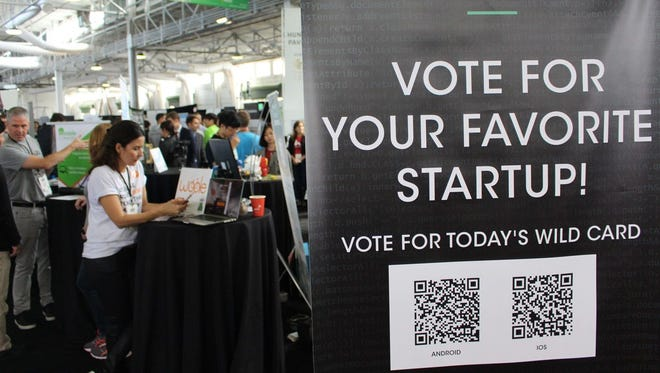 Tech startups vie for investors, fans, and media attention at a TechCrunch Disrupt conference in San Francisco on September 18, 2017. The technology industry's racial gap is getting worse, new research from the Ascend Foundation says.