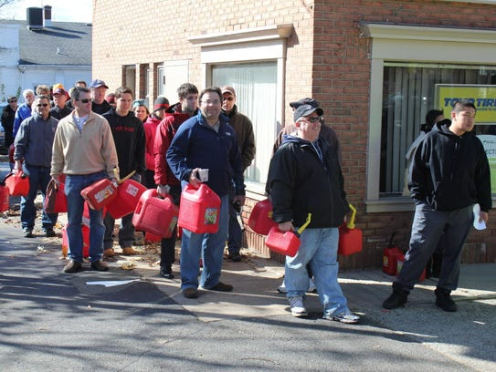 Residents line up at Maple Rock Exxon station for precious