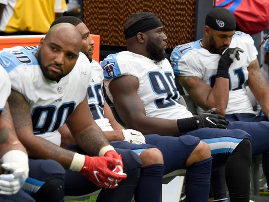 The Titans defense sits dejectedly on the bench during