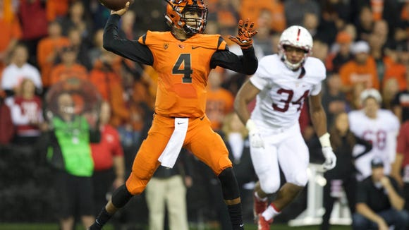 Sep 25, 2015; Corvallis, OR, USA; Stanford Cardinal linebacker Peter Kalambayi (34) runs toward Oregon State Beavers quarterback Seth Collins (4) as he throws the ball in the first half at Reser Stadium. Mandatory Credit: Scott Olmos-USA TODAY Sports