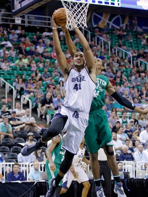 Utah Jazz's Trey Lyles (41) drives to the basket as Boston Celtics' Malcolm Miller (48) defends during the second half of an NBA summer league basketball game Tuesday, July 5, 2016, in Salt Lake City. (AP Photo/Rick Bowmer)