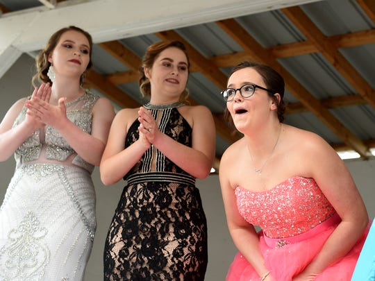 Ridgewood senior Keirstan Hall, 17, (right) reacts after being names queen during the 2018 Coshocton Hot Air Balloon Festival opened on Thursday, June 7, 2018 at the Coshocton County Fairgrounds. Ridgewood senior Aliyah Guthrie, 16, and River View senior Kellyn Donaker, 16, also competed in the annual event.