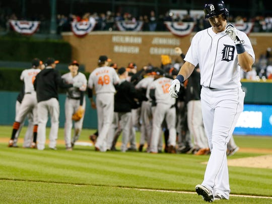 Detroit Tigers Hernan Perez walks off the field as the Orioles celebrate their 2 -1 to win in the ALDS series in three games.