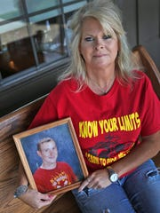 Patty Reyling shows a photo, Wednesday, June 8, 2016, of her son Kenny McDaniel who was killed in an ATV accident on January 1, 2004.  She now works for ATV safety, urging people to take safety precautions.