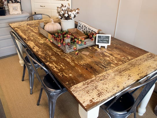 A barn-door table, at White Pines Vintage Farmhouse,