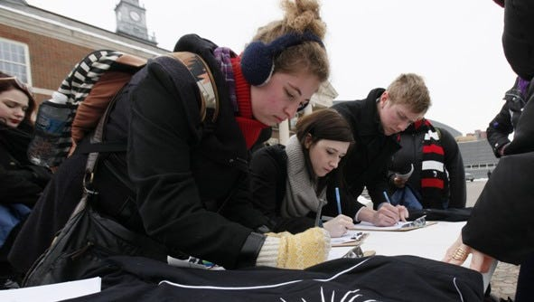 From left, Samantha Stephenson, Sarah Jewell and Peter Oehrtman where among the people who signed a ballot inattentive for gay marriage, Ohioans for Marriage Equality was on the campus of the University of Cincinnati gathering signatures.