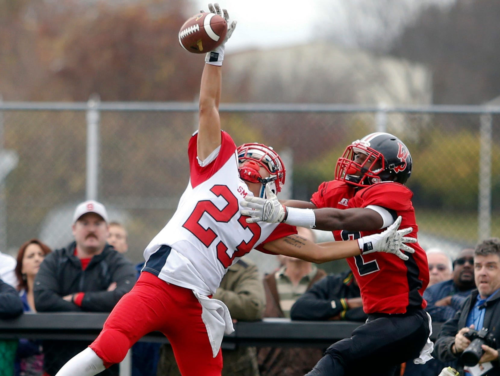 Smyrna defensive back Jeremy D'Aguiar breaks up a fourth down pass in the end zone intended for William Penn's Chi Chi Amachi in the first quarter of Smyrna's 30-13 win in a semifinal of the DIAA Division I state tournament at Bill Cole Stadium Saturday.