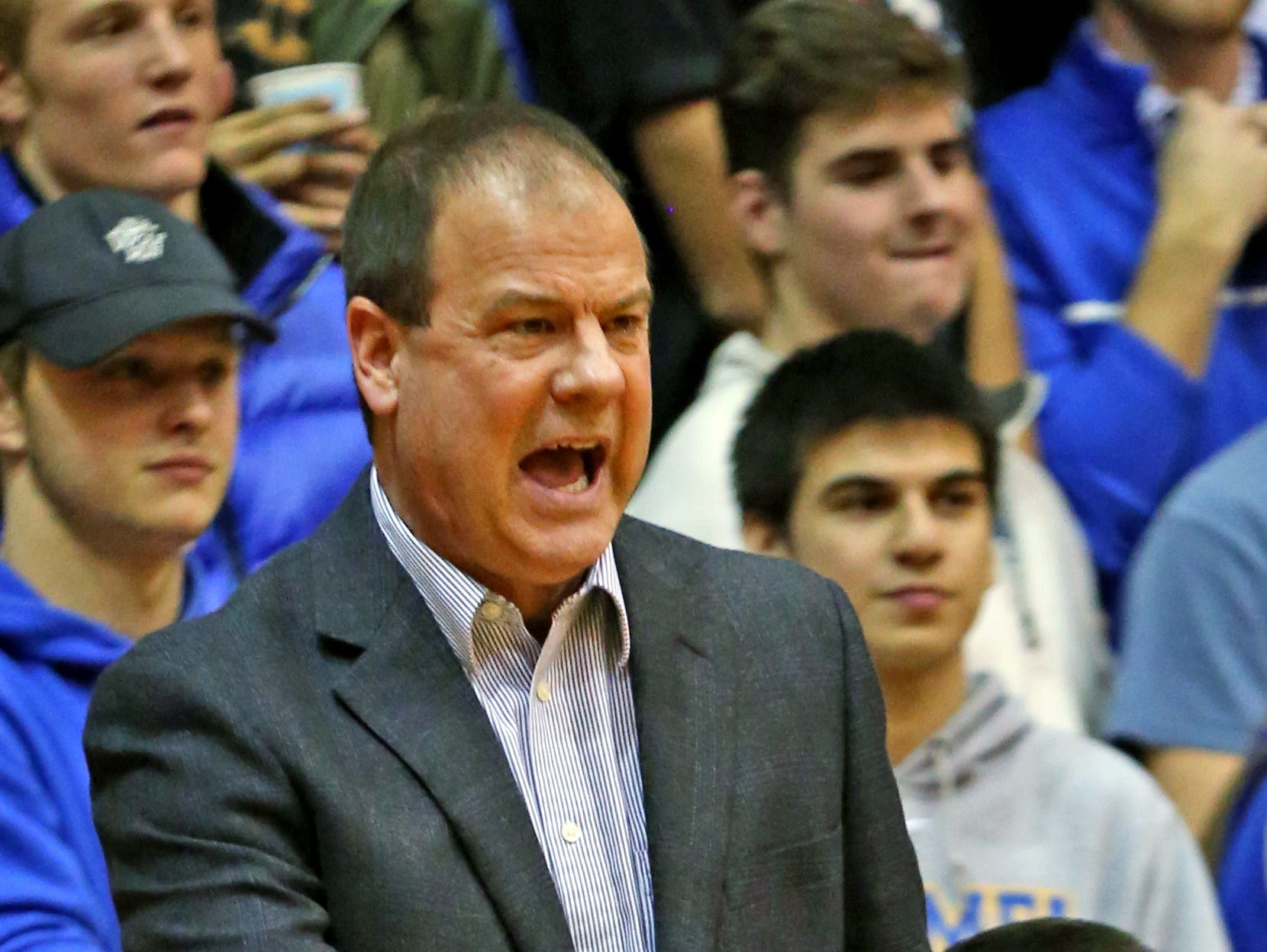 FILE -- Carmel Coach Scott Heady yells to his team during first half action of the Carmel at North Central High School boys basketball game, Friday, December 16, 2016.