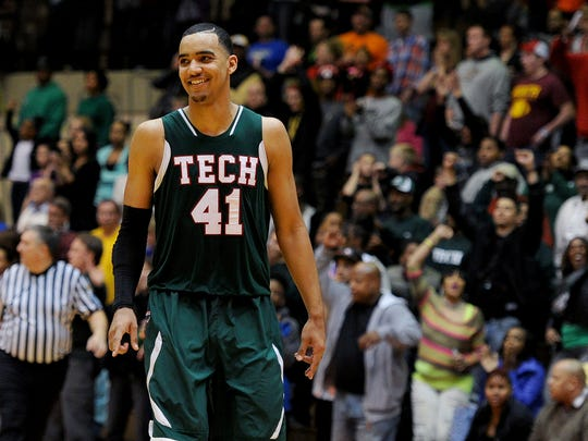 Tech forward Trey Lyles was all smiles when the game ended against Bloomington North during the Class 4A Semistate game, March 22, 2014.