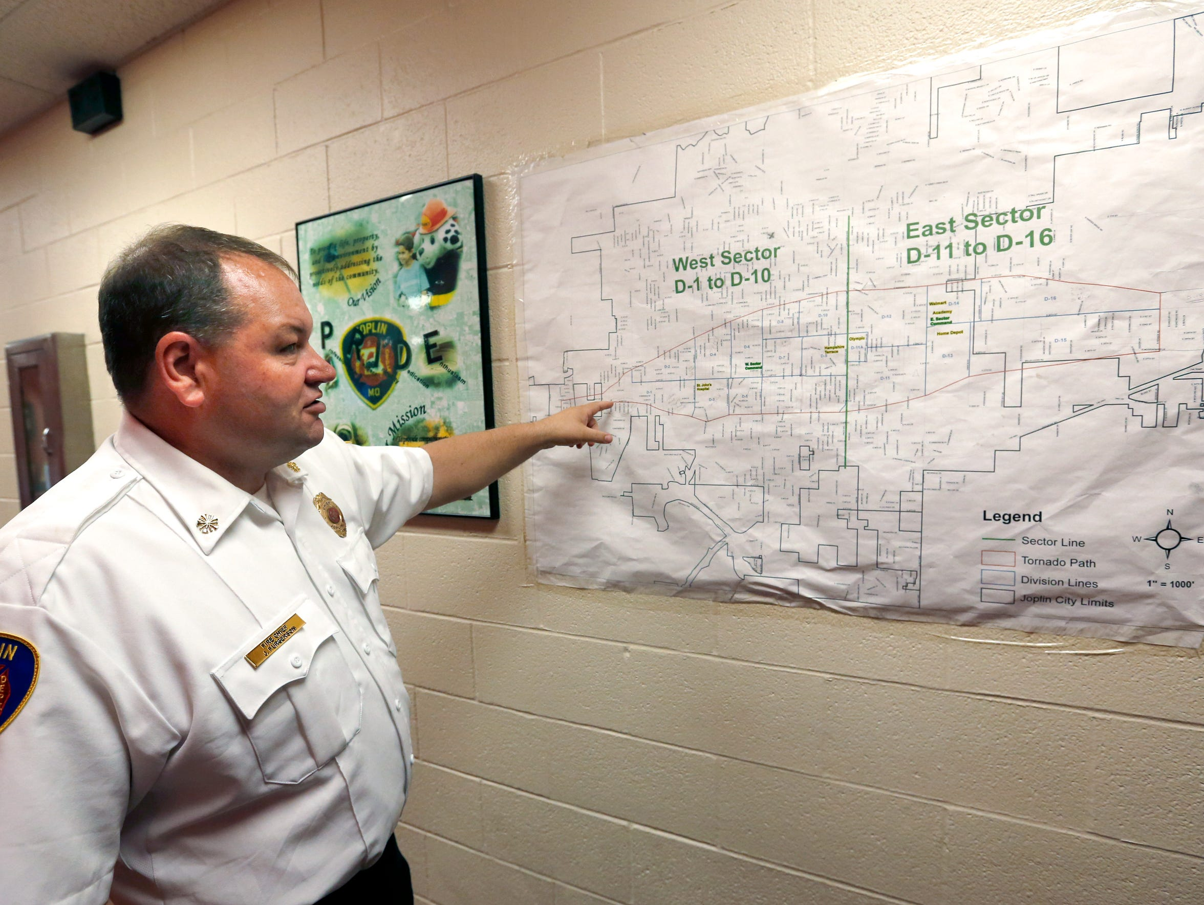 Joplin Fire Department Chief James Furgerson shows