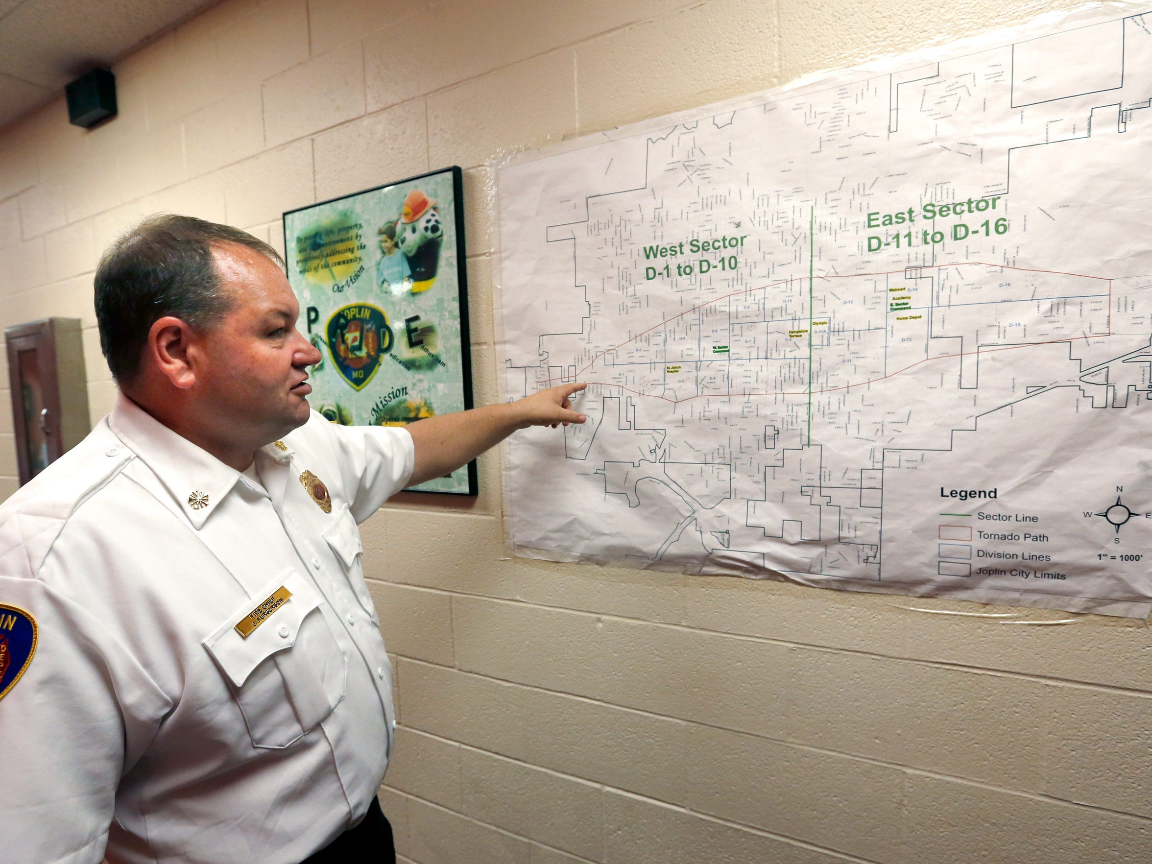 Joplin Fire Department Chief James Furgerson shows the path of the 2011 tornado on a map at a fire station on Friday, May 13, 2016. Furgerson was a Battalion Chief in the department when the tornado hit.