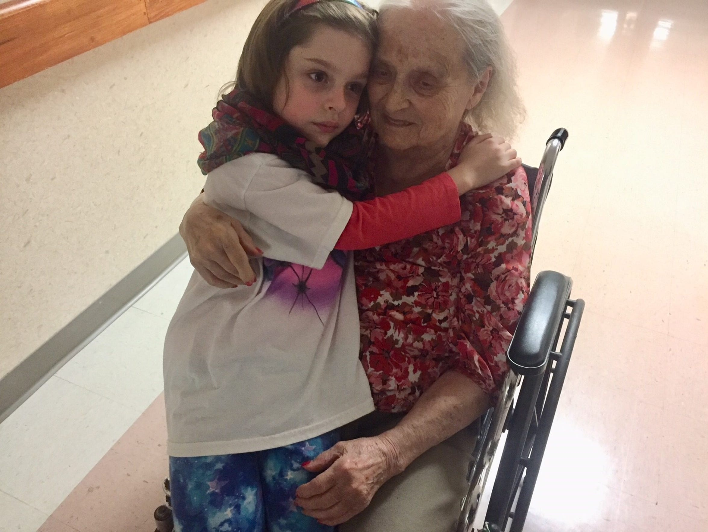 Helen Harney enjoys a visit from her great-granddaughter,