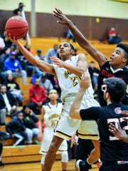 Piscataway's Mattias Arrindell (left) drives to the