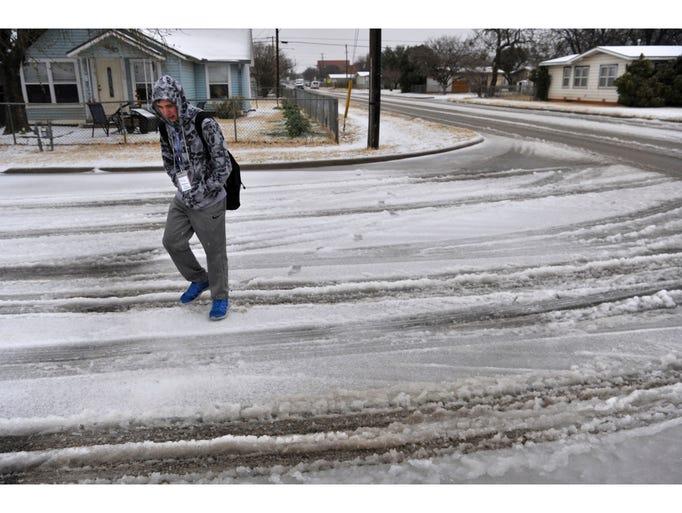 Abilene High School student Trey Robinson walks home