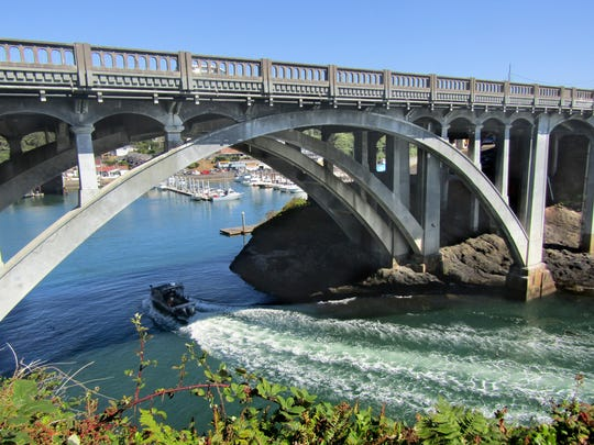 Depoe Bay's entrance under Highway 101 is a 50-foot-wide channel between lava walls.