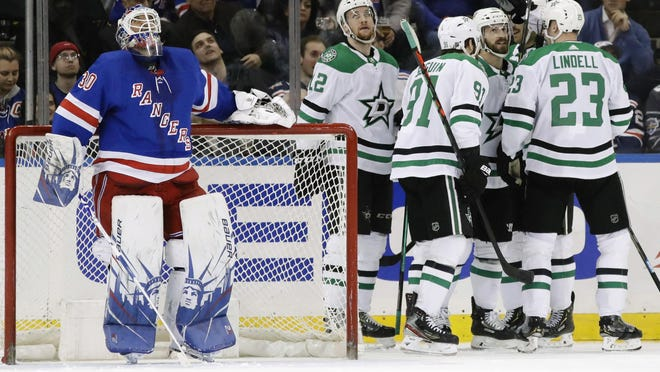 Rangers goaltender Henrik Lundqvist (30) reacts as the Dallas Stars celebrate a goal by Blake Comeau during the second period.