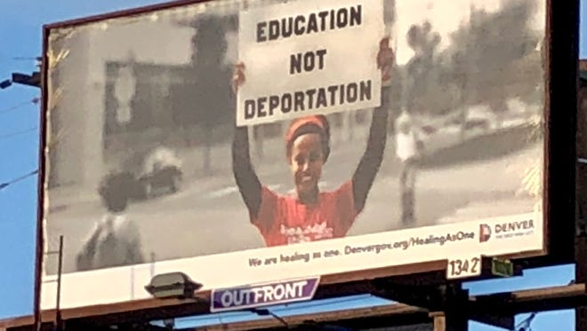 """A city of Denver billboard calls for """"Education Not Deportation,"""" and was erected as part of the city's """"Healing As One"""" initiative."""