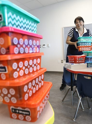 Sgt. Jose F. Carrasco Elementary School pre-kinder teacher Ana Rodriguez gets her classroom at the new SISD school ready for student who will arrive Monday. The school in far east El Paso is expecting about 700 students when they open their doors.
