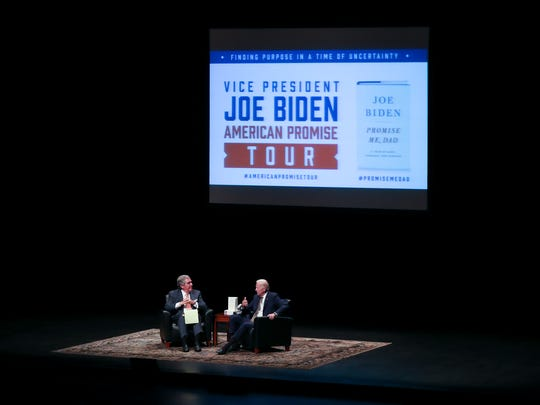 """Former Vice-President Joe Biden, right, spoke with former Louisville Mayor Jerry Abramson during a discussion on Biden's book tour for """"Promise Me, Dad—A Year of Hope, Hardship, and Purpose"""" at The Kentucky Center for the Performing Arts.June 7, 2018"""