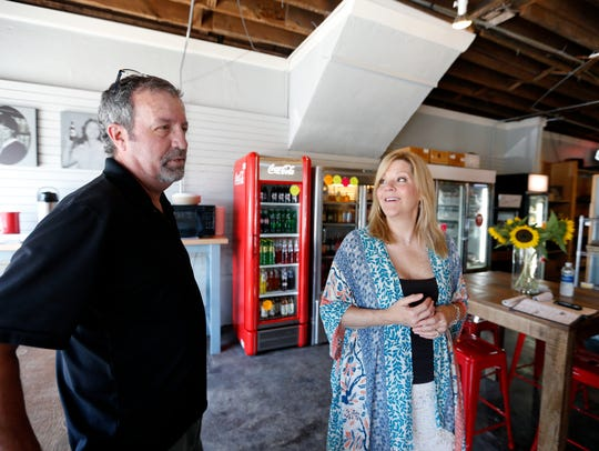Rob Bailey, left, is running on the Democratic ticket to represent Missouri House District 135. In this 2016 photograph, he is show with his wife, Jackie Bailey, at their Homegrown Food store on South Pickwick Avenue.