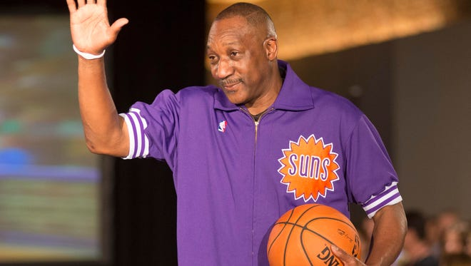 Retired Suns player Walter Davis shows off his generation's team apparel during a fashion show unveiling the new Suns uniforms on Thursday, August 15, 2013 at Scottsdale Fashion Square.