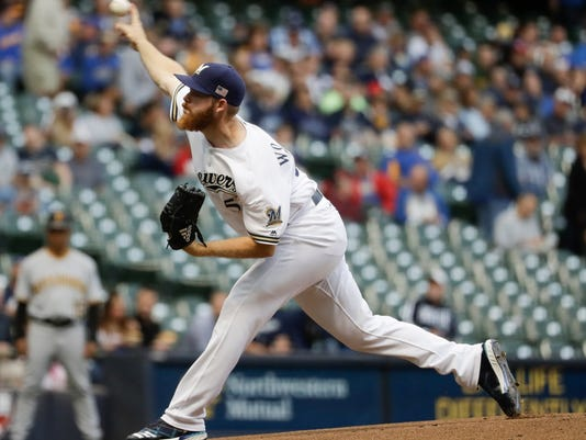 Milwaukee Brewers starting pitcher Brandon Woodruff throws during the first inning of a baseball game against the Pittsburgh Pirates Monday, Sept. 11, 2017, in Milwaukee. (AP Photo/Morry Gash)