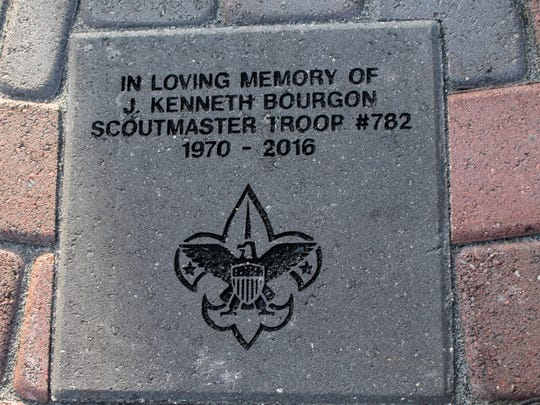 A paver installed in honor of Ken Bourgon, the late