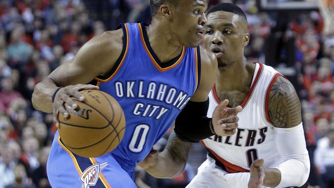 Oklahoma City Thunder guard Russell Westbrook (left) drives past Portland Trail Blazers guard Damian Lillard on Oct. 29. Westbrook underwent surgery on his broken right hand after a loss to the Los Angeles Clippers on Oct. 30 and is expected to miss 4-to-6 weeks.