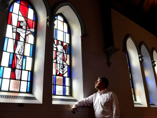 David Baulch looks at stand glass windows in the chapel