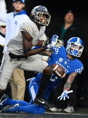 Vanderbilt cornerback Joejuan Williams (8) breaks up a pass intended for Kentucky wide receiver Blake Bone (6) last season.