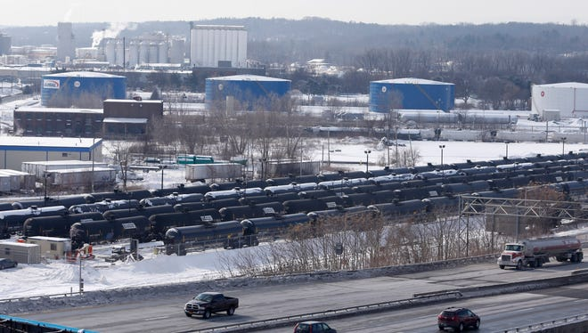 A view from a nearby apartment building shows vehicles driving along Interstate 787 past railroad oil tanker cars that are lined up at Global Partners at the Port of Albany. The Port of Albany has become a hub for the U.S. oil business, taking shipments from North Dakota's Bakken Shale daily by mile-long trains and shipping it in tankers down the Hudson River to refineries.