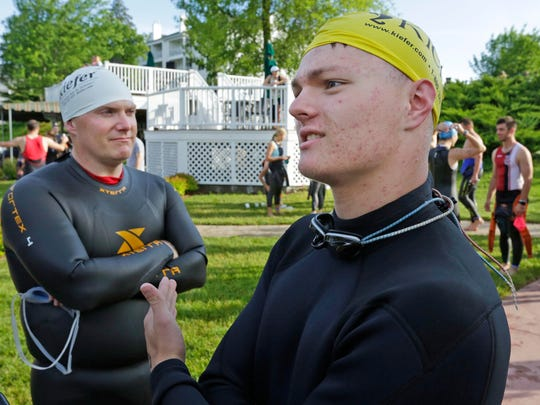 Jake Hittman, 17, of Sheboygan talks about his friendship with the late Sean Zempel before competing in Zempel's honor at the Elkhart Lake Triathlon Saturday June 11, 2016 at Elkhart Lake.  At left is the Zempel's father Kurt.