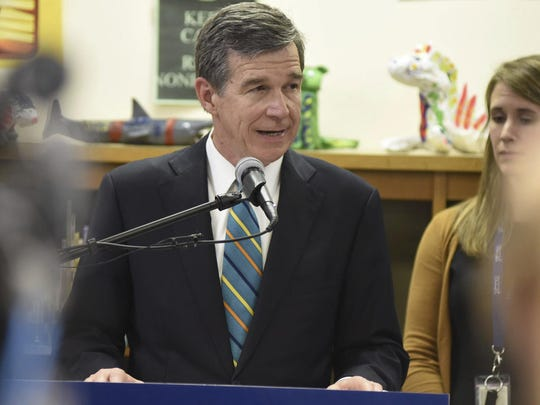 N.C. Gov. Roy Cooper speaks at Bradley Creek Elementary School in Wilmington. North Carolina's highest court for the first time wades into the long-running and multilayered effort by Republican state legislators to strip away as many layers of power as possible from Cooper. The state Supreme Court heard from attorneys Monday over Cooper's claim that a law diminishing the governor's authority to oversee election operations is unconstitutional.