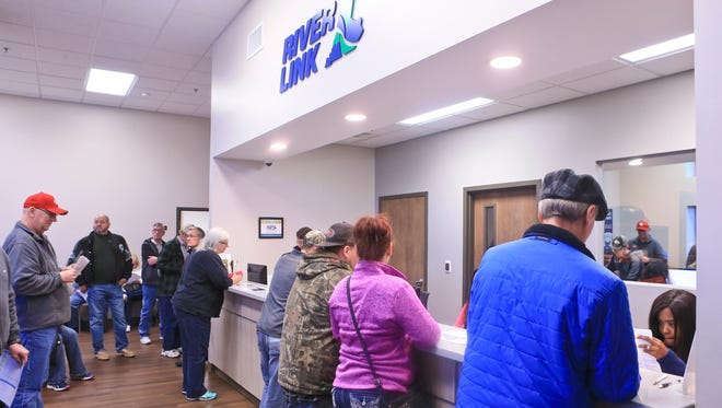 It was crowded at the RiverLink Jeffersonville office Friday morning with waits up to an hour and a half for those seeking a toll transponder in person.